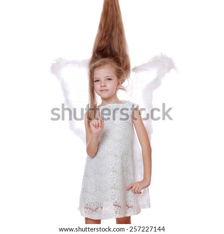 Portrait of modern little angel on Christmas on Holiday theme - stock photo
