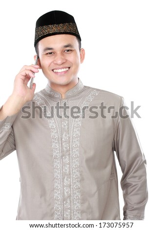 portrait of modern muslim man calling by mobile phone isolated over white background