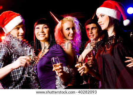 Portrait of modern young people enjoying themselves at New Year party - stock photo