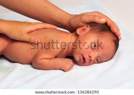 Portrait OF Mom Playing With Newborn - stock photo