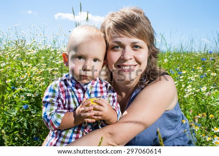 portrait of mother and baby outdoor