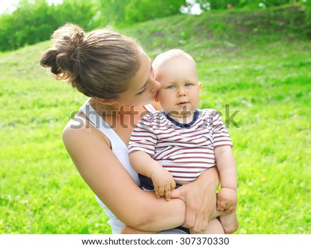 Portrait of mother and child together in summer day