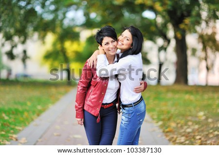 Portrait Of Mother And Daughter In a Park - stock photo