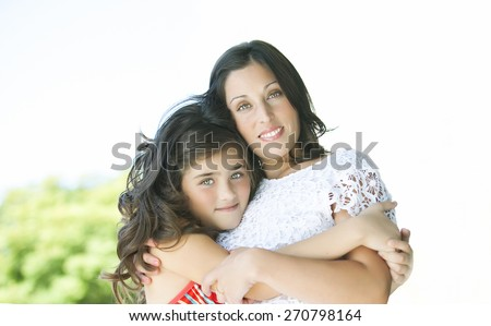 Portrait of mother and her beautiful child daughter - stock photo