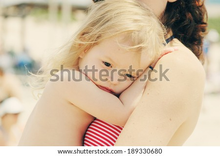 Portrait of mother and her daughter on the beach - stock photo