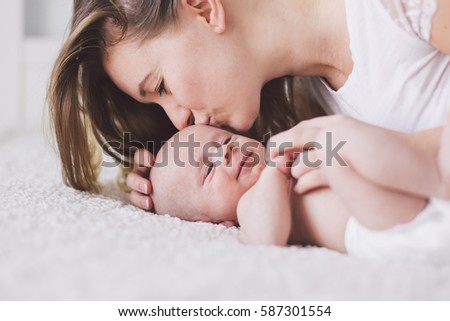 Portrait of mother and her newborn baby.