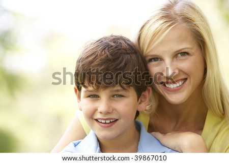 Portrait Of Mother And Son In Park