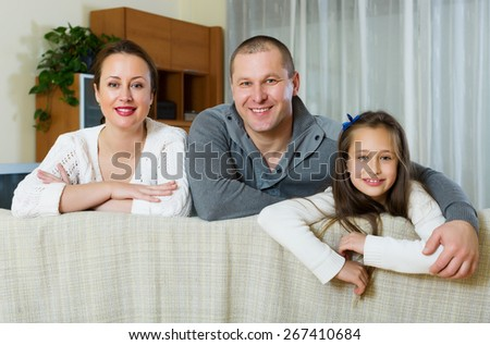 Portrait of mother, father and cute  daughter at home - stock photo