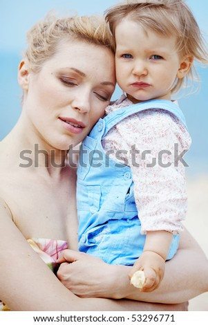 Portrait of mother holding her lovely child