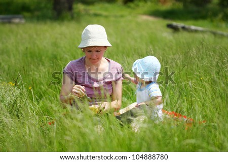 Portrait of mother with baby on picnic - stock photo
