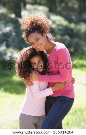 Portrait Of Mother With Daughter In Countryside - stock photo