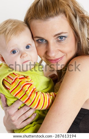 portrait of mother with her baby girl - stock photo