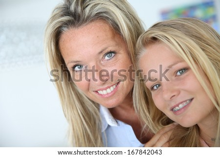 Portrait of mother with teenaged daughter