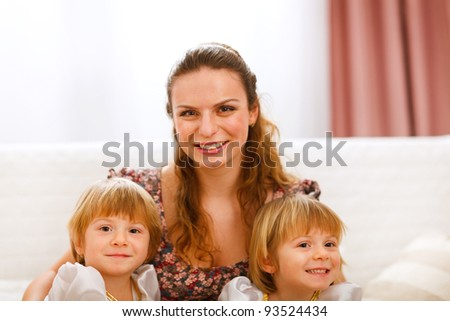 Portrait of mother with twins daughters