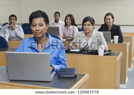 Portrait of multi ethnic business people working in office