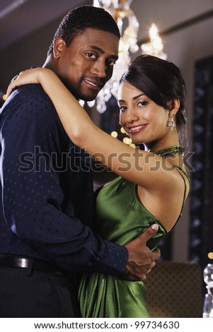Portrait of multi-ethnic couple hugging - stock photo