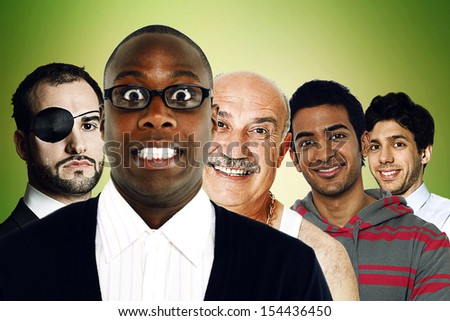 Portrait of multi ethnic friends standing in front of green background  - stock photo