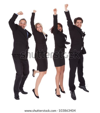 Portrait of multi ethnic team of business people rejoicing success on white background - stock photo