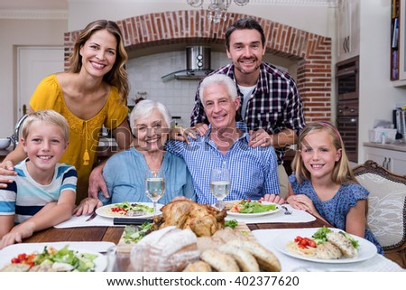Portrait of multi-generation family having meal at home - stock photo