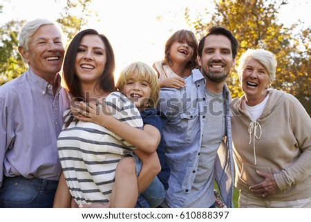 Portrait Of Multi Generation Family Standing In Park