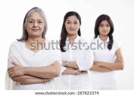 Portrait of multi generation family standing over white background - stock photo