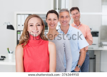Portrait of multiethnic business team smiling together in office