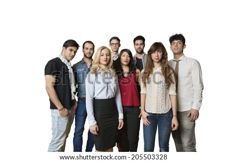 Portrait of multiethnic group of friends standing together over colored background