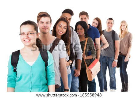 Portrait of multiethnic university students standing in a row isolated over white background