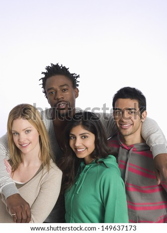 Portrait of multiethnic young people against white background