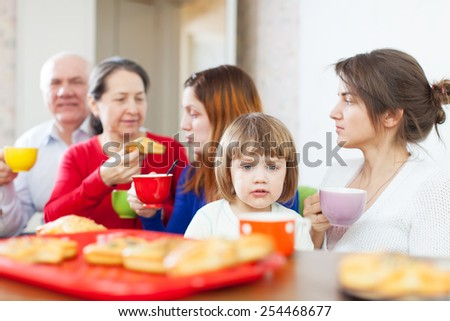 Portrait of multigeneration family having breakfast at home together