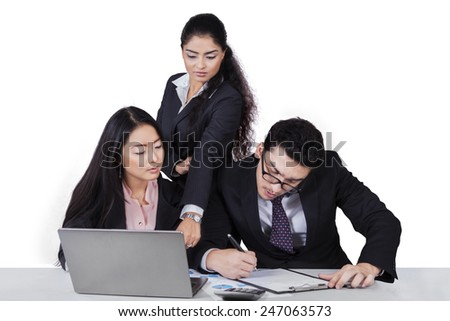 Portrait of multiracial businesspeople working with laptop computer on table, isolated on white