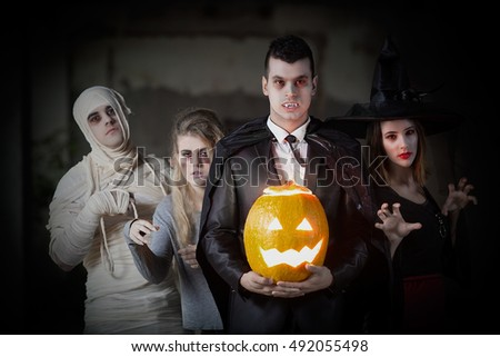 Portrait of Mummy, Zombie, Witch and Vampire with Jack O' Lantern