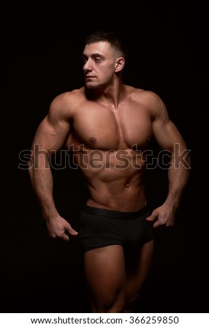 Portrait of muscular bodybuilder on black background.Studio shot
