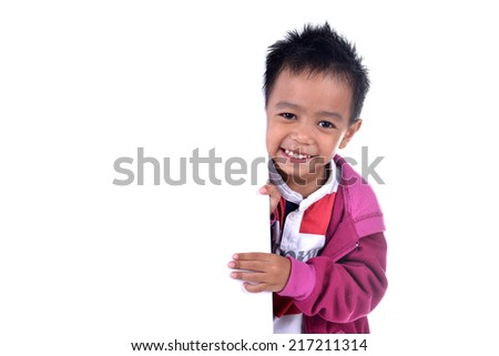Portrait of muslim kid holding a blank white board isolated over white background - stock photo