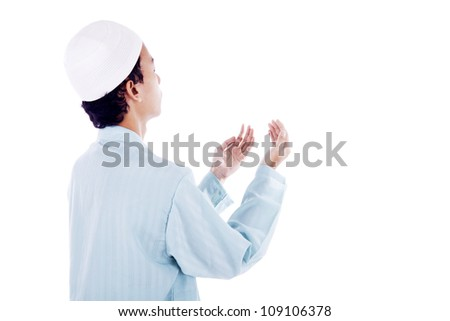 Portrait of muslim man worshiping to god. shot in studio isolated on white - stock photo