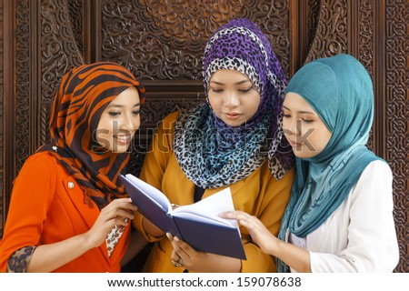 Portrait of Muslim student wearing Hijab outdoor  - stock photo