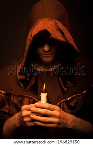 Portrait of mystery unrecognizable monk in robe