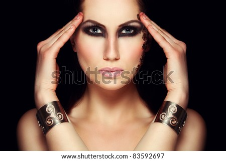 Portrait of mystic woman with extravagant make up. Retouched - stock photo