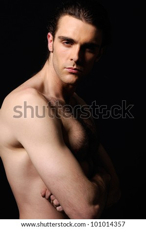 portrait of naked attractive positive young man,
