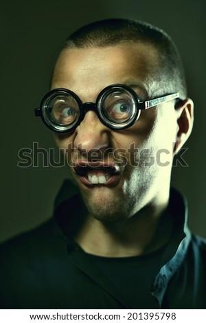 Portrait of nerd guy in glasses  - stock photo