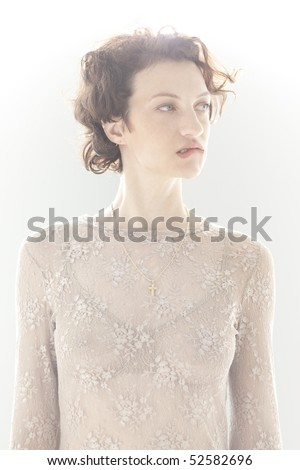 Portrait of nervous woman biting lip - stock photo