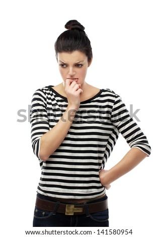 Portrait of nervous young woman biting her lips. - stock photo