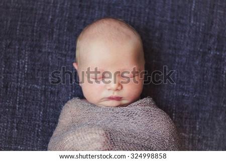 Portrait of newborn baby boy - stock photo