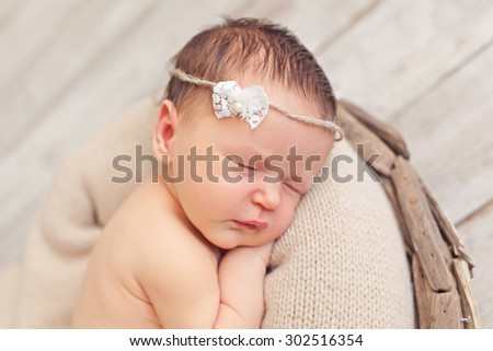 Portrait of newborn baby girl - stock photo