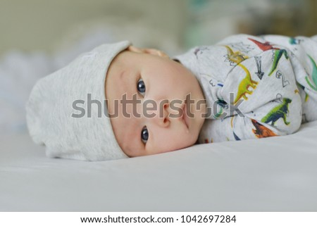portrait of newborn baby laying on the bed