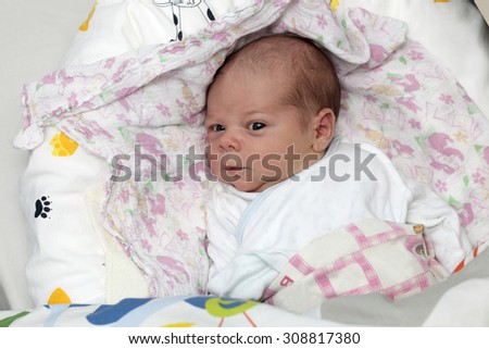 Portrait of newborn baby on the bed at home - stock photo