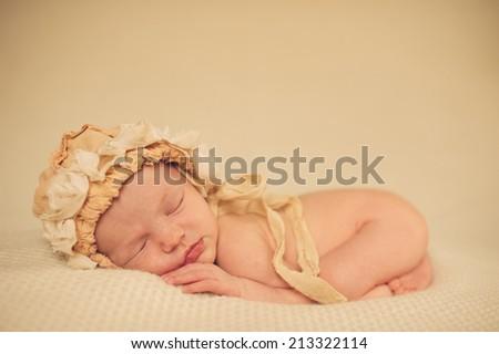 Portrait of Newborn Baby Sleeping in Hat - stock photo