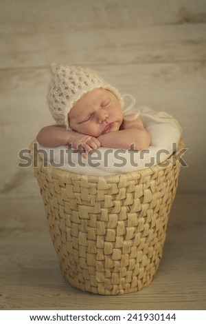 Portrait of Newborn Baby Sleeping on Hands