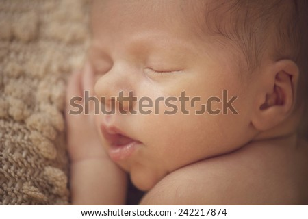 Portrait of Newborn Baby Sleeping Peacefully - closeup