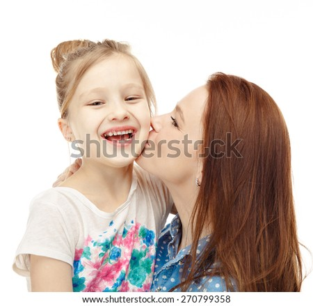 Portrait of nice girl (child, kid) with mother on white background , pretty woman and cute cheerful child play game; happy smiling young lady hugging daughter - family and mother`s day concept - stock photo